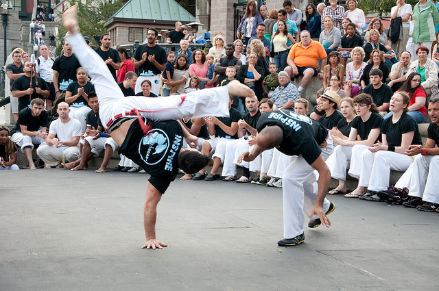 Mestra Tico Tico (left) and Professor Canela (right) from Grupo Ondas Capoeira at WaterFire Providence. Photo by Jeffrey Stolzberg.